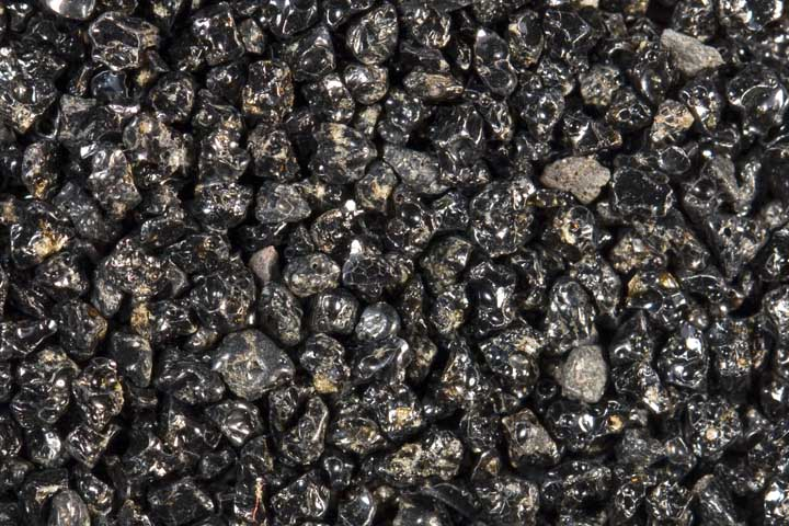 Black sand composed of volcanic glass.