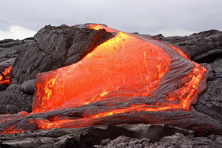 Glowing lava forming new land in Hawaii. Kilauea volcano, Pu'u O'o vent.
